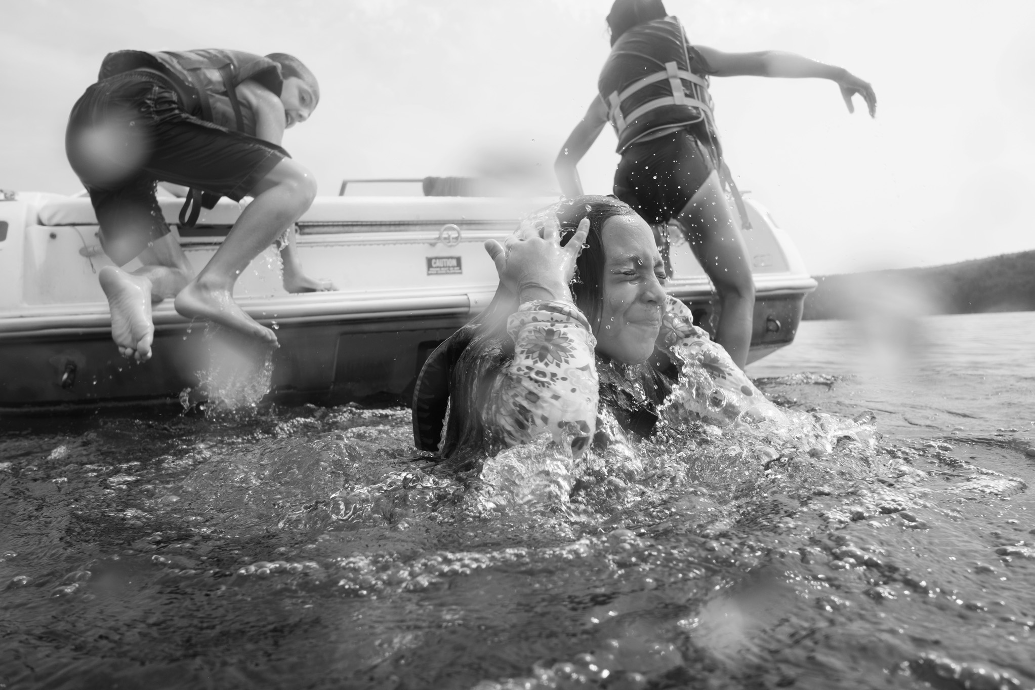 kids jumping in a lake. underwater family portraiture by Erin Borzellino in NYC metro area