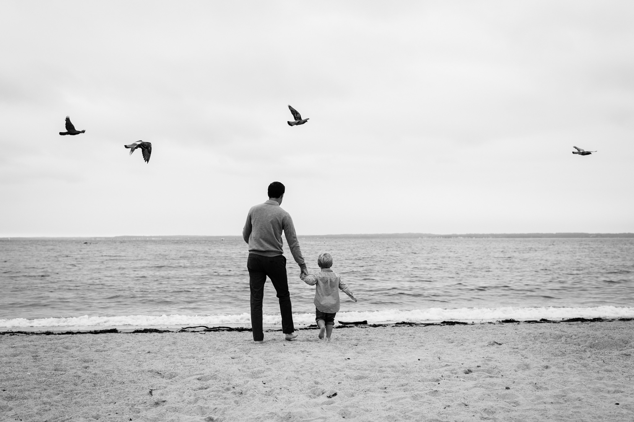 father and son portrait at the beach by Erin Borzellino.  Rye, NY portrait photographer