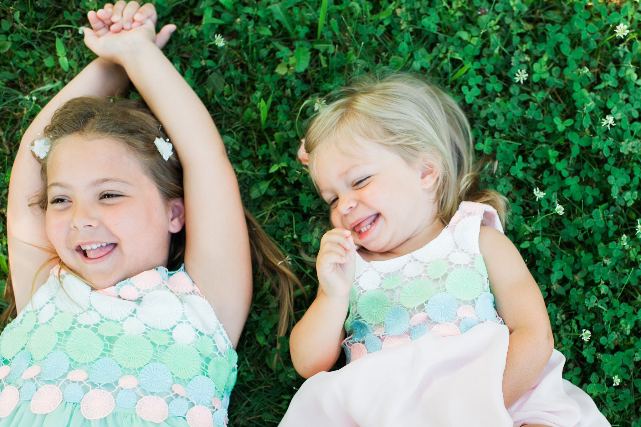 portrait of sisters giggling by Erin Borzellino. Award winning portrait photographer