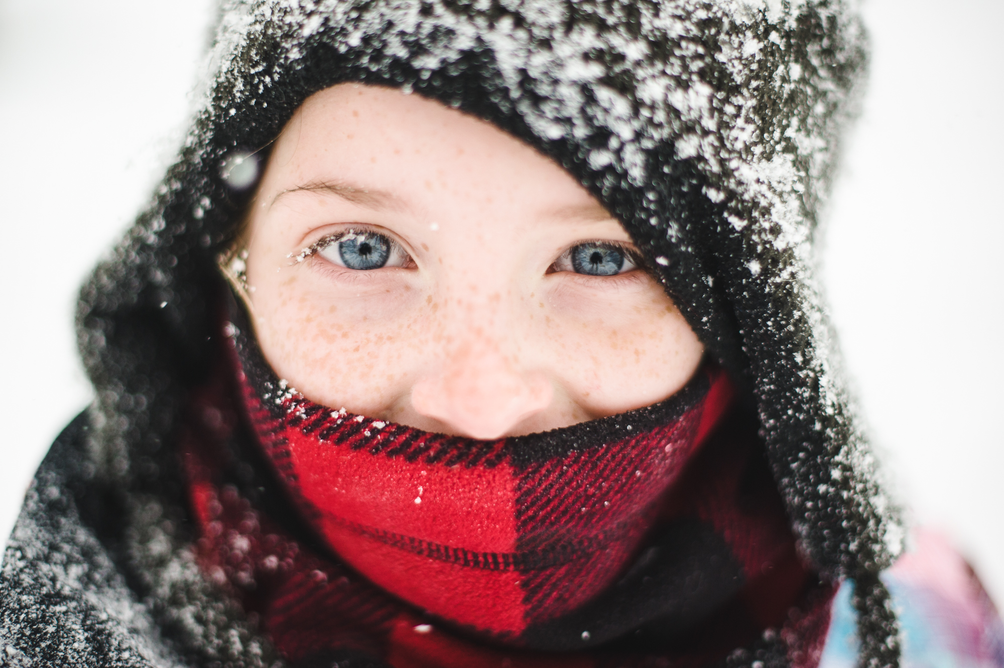 girl with freckles in snow portrait by Erin Borzellino