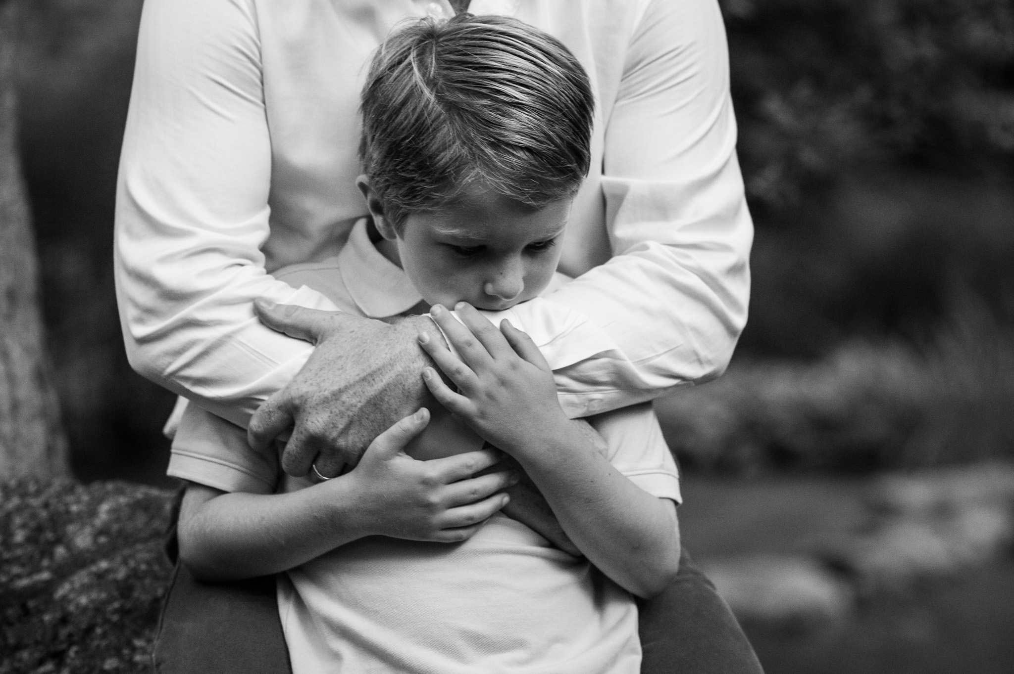 father hugging son. portrait by Erin Borzellino in Harrison, NY