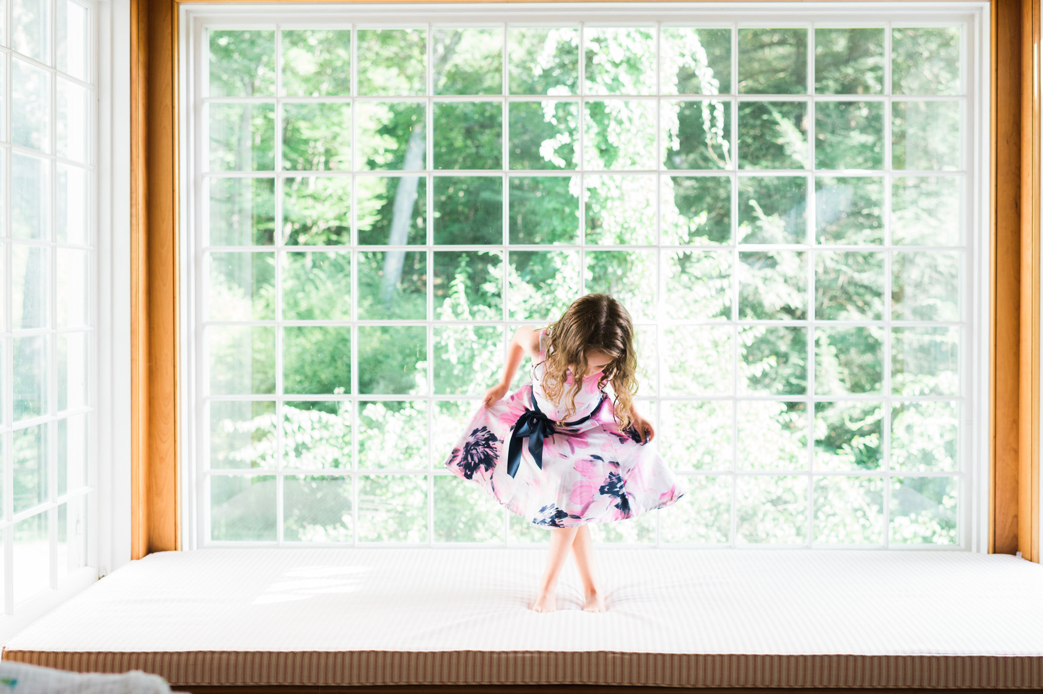 girl on window seat . portrait by Erin Borzellino .  Connecticut portrait photographer