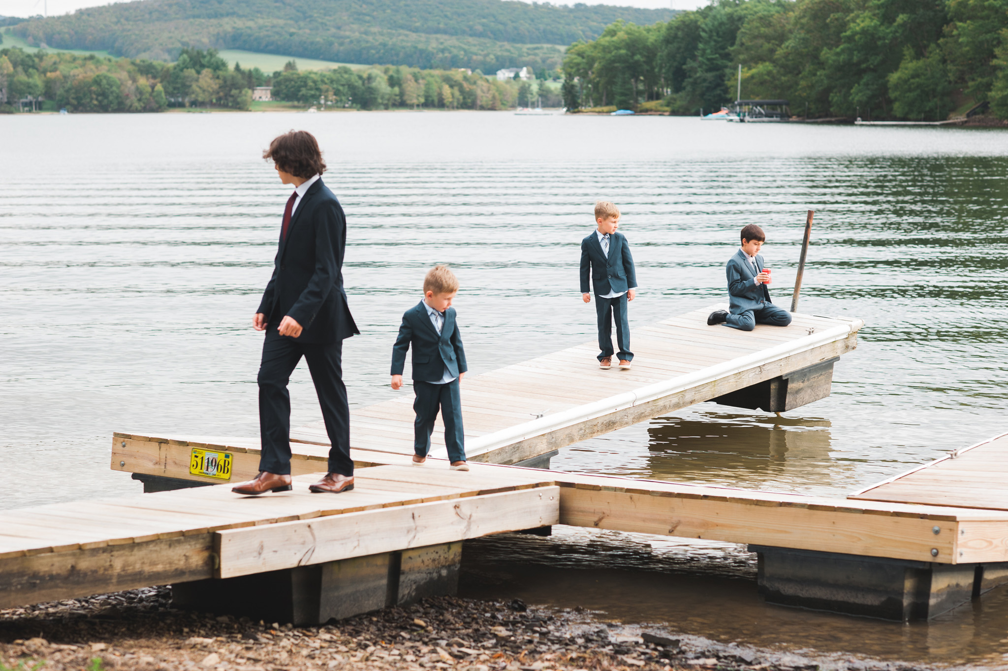 kids playing at a wedding reception on a dock. Documentary wedding photography by Erin Borzellino